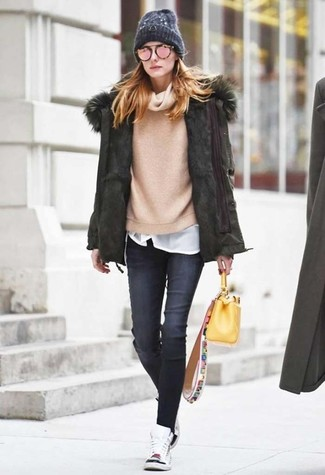 How to wear: olive parka, beige cowl-neck sweater, white crew-neck t-shirt, charcoal skinny jeans