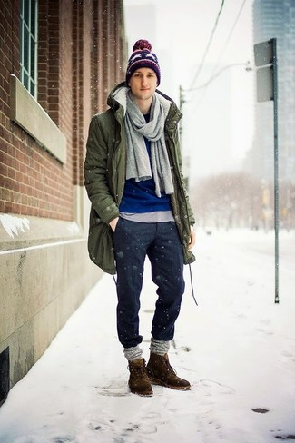 How to wear: olive parka, blue crew-neck sweater, grey crew-neck t-shirt, charcoal wool chinos
