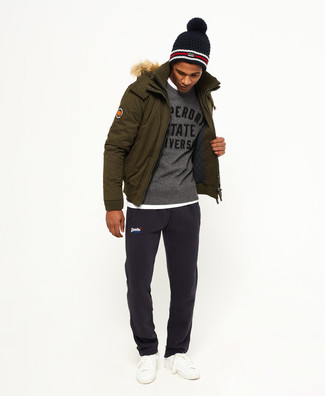 How to wear: olive parka, grey print crew-neck sweater, white crew-neck t-shirt, navy sweatpants