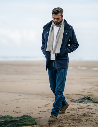 How to wear: navy parka, white crew-neck sweater, blue jeans, olive suede desert boots