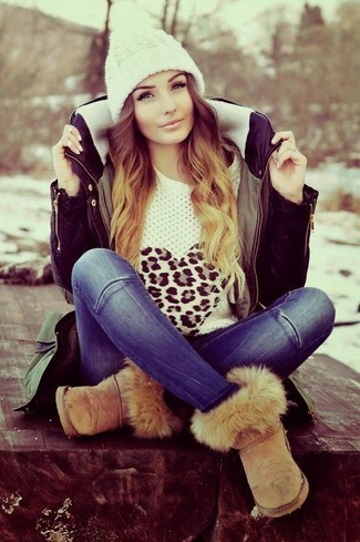 How to wear: olive parka, white leopard crew-neck sweater, blue jeans, tan uggs