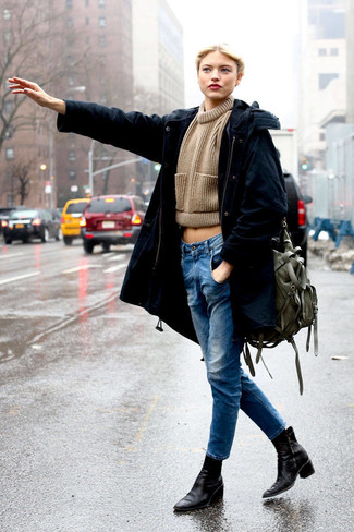 A black parka and blue jeans is a savvy combination to carry you throughout the day. Take a classic approach with the footwear and go for a pair of black leather booties. We love how great this one is for in-between weather.