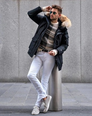 How to wear: black parka, beige horizontal striped crew-neck sweater, white jeans, grey suede low top sneakers