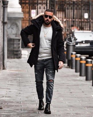 How to wear: black parka, grey crew-neck sweater, charcoal ripped jeans, black leather chelsea boots
