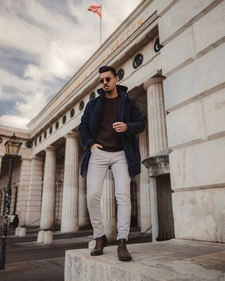 Dark Green Sunglasses Outfits For Men: Pair a navy lightweight parka with dark green sunglasses to achieve a bold casual and absolutely dapper outfit. Dark brown leather chelsea boots will put a different spin on your outfit.