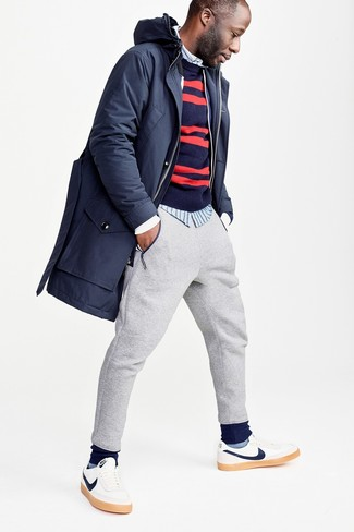 How to wear: navy parka, navy and red horizontal striped crew-neck sweater, light blue vertical striped long sleeve shirt, grey sweatpants