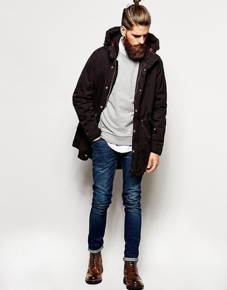 A parka and navy slim jeans will convey a carefree easy vibe. Dress up your getup with brown leather brogue boots.