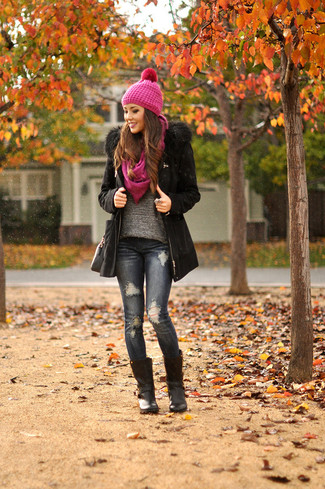 How to wear: black parka, grey crew-neck sweater, navy ripped skinny jeans, black leather mid-calf boots