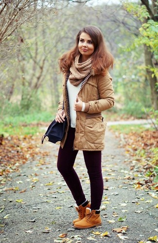 Dark Purple Skinny Jeans Outfits: The mix-and-match capabilities of a tan parka and dark purple skinny jeans ensure you'll always have them on regular rotation in your wardrobe. Add a pair of tan leather lace-up flat boots to your outfit and ta-da: the outfit is complete.