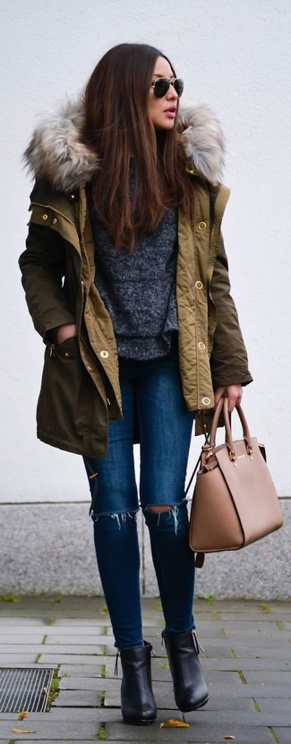 If you're a fan of classic pairings, then you'll like this combination of an army green parka and blue ripped slim jeans. Black leather ankle boots will add a touch of polish to an otherwise low-key look.