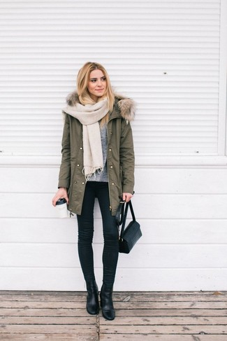 How to wear: olive parka, grey crew-neck sweater, black skinny jeans, black leather ankle boots