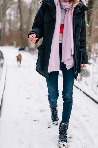 How to wear: black parka, multi colored horizontal striped crew-neck sweater, navy skinny jeans, black suede snow boots