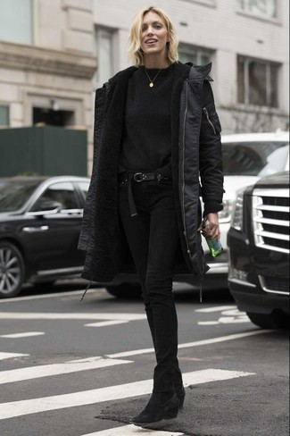 How to wear: black parka, black crew-neck sweater, black skinny jeans, black suede ankle boots