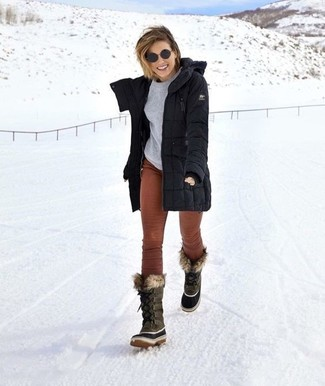 How to wear: black parka, grey crew-neck sweater, brown corduroy skinny pants, grey snow boots