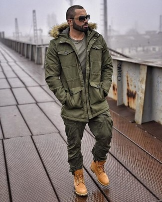 How to wear: olive parka, olive crew-neck t-shirt, olive cargo pants, tobacco suede work boots