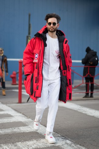 How to wear: red parka, white and red print crew-neck t-shirt, white chinos, white leather low top sneakers