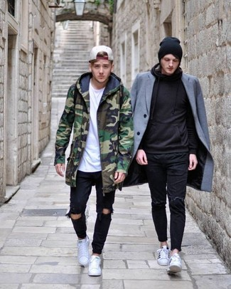 How to wear: green camouflage parka, white crew-neck t-shirt, black ripped jeans, white low top sneakers