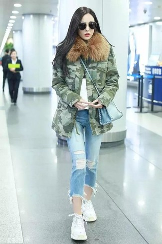 Try teaming an olive camouflage parka with light blue ripped jeans for a casual coffee run. White athletic shoes will add a new dimension to an otherwise classic look. This look is absolutely perfect to welcome spring.