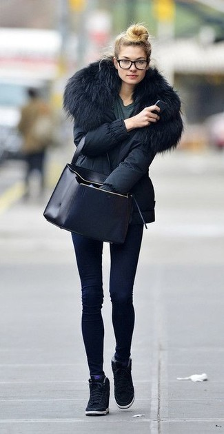 How to wear: black parka, charcoal crew-neck t-shirt, navy skinny jeans, black suede wedge sneakers