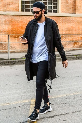 How to Wear Black Skinny Jeans For Men: You'll be surprised at how easy it is for any gent to get dressed this way. Just a black parka and black skinny jeans. On the shoe front, this outfit pairs well with black athletic shoes.