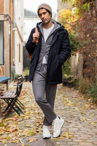 White Crew-neck T-shirt Outfits For Men: If you're a fan of laid-back combinations, then you'll appreciate this combo of a white crew-neck t-shirt and a navy parka. Let your styling credentials really shine by rounding off this look with a pair of white athletic shoes.