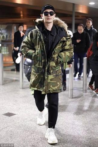 How to wear: olive camouflage parka, black denim jacket, black crew-neck t-shirt, black sweatpants