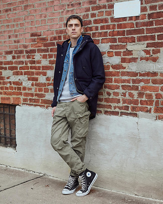 1152+ Winter Outfits For Men: Choose a navy wool parka and olive cargo pants to achieve a modern casual and practical ensemble. Black and white canvas high top sneakers are the glue that ties this outfit together. An amazing example of practical fashion, this ensemble must be in your sartorial collection this winter season.