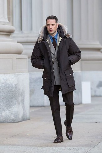 How to wear: dark brown parka, grey double breasted blazer, blue denim shirt, dark brown dress pants
