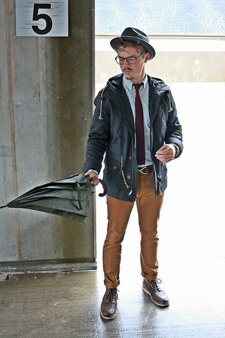 Khaki Chinos Outfits: Pair a navy parka with khaki chinos to showcase you've got serious styling prowess. If you want to break out of the mold a little, complement this ensemble with a pair of dark brown leather brogue boots.