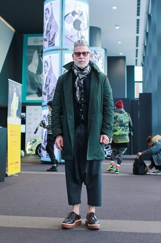 Nick Wooster wearing Dark Green Parka, Navy Quilted Gilet, Black Cardigan, Teal Chinos