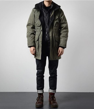 How to Wear Black Jeans For Men: Why not try pairing an olive parka with black jeans? As well as super practical, these pieces look amazing paired together. Rounding off with dark brown leather work boots is the simplest way to bring a mellow feel to this getup.