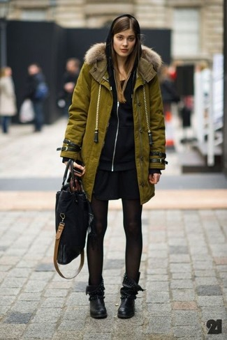 How to wear: olive parka, black hoodie, black casual dress, black leather mid-calf boots