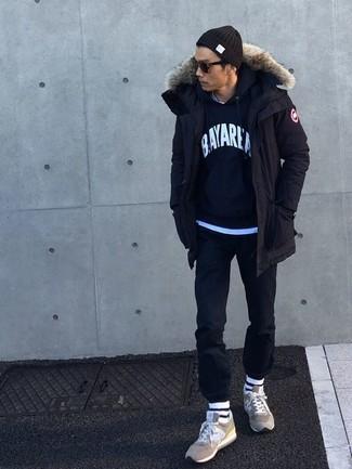 How to wear: black parka, navy print hoodie, light blue crew-neck t-shirt, black chinos