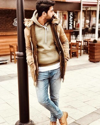 Work Boots Outfits For Men: Putting together a tan parka with light blue ripped jeans is an awesome choice for a casual outfit. Work boots are a smart idea to complement this look.