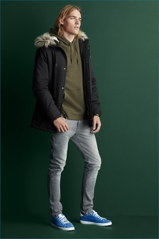 Grey Jeans Outfits For Men: This edgy combo of a black parka and grey jeans is super easy to put together in next to no time, helping you look awesome and ready for anything without spending too much time combing through your wardrobe. Introduce blue suede low top sneakers to the mix and the whole outfit will come together.