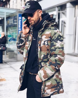 How to wear: olive camouflage parka, black hoodie, black skinny jeans, black and white print baseball cap