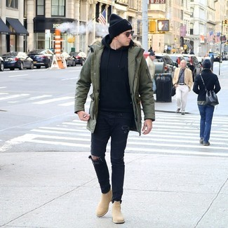 How to wear: olive parka, black hoodie, black ripped skinny jeans, tan suede chelsea boots