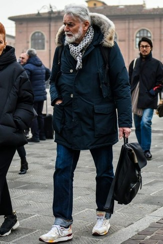 How to Wear a Navy Parka For Men: A navy parka and navy jeans are a casual street style combination that every modern guy should have in his off-duty styling rotation. White athletic shoes can easily tone down an all-too-dressy outfit.