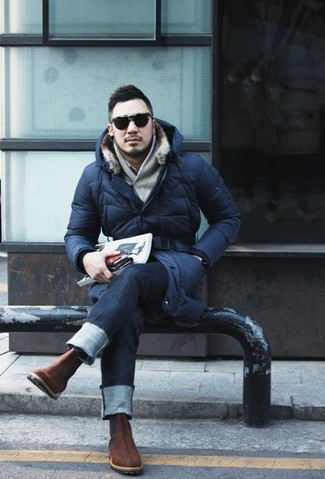 A parka and deep blue jeans will convey a carefree easy vibe. Dark brown nubuck chelsea boots will add a touch of polish to an otherwise low-key look.