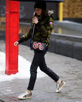 If you're a fan of staying-in clothes which are stylish enough to wear out, you should try this combination of an olive camouflage parka and a black print leather crossbody bag. Tan leopard low top sneakers work amazingly well with this outfit. Seeing as temps are dropping, this ensemble is a wise pick for the transitional season.