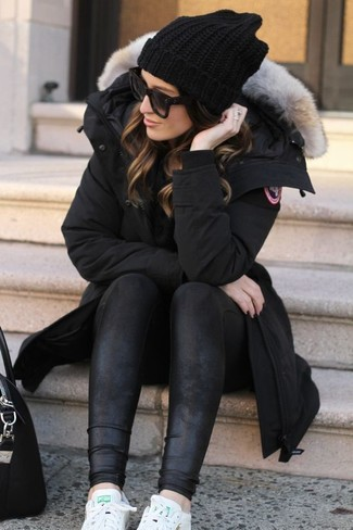 Something as simple as opting for a black parka and black leather leggings can potentially set you apart from the crowd. And if you want to instantly up the style ante of your look with one piece, add white leather low top sneakers to the equation. Sunnier days call for cooler outfits like this one.