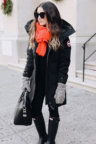 How to wear: black parka, black leggings, black rain boots, black leather tote bag