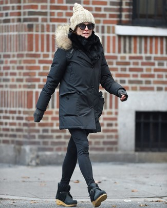 How to wear: black parka, black leggings, black leather wedge ankle boots, beige knit beanie