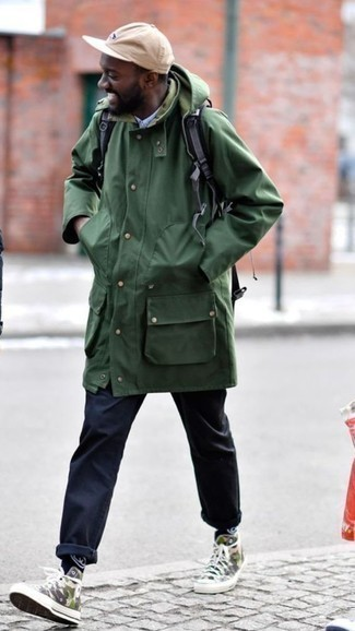 How to Wear a Baseball Cap For Men: One of the most popular ways for a man to style a dark green parka is to combine it with a baseball cap in a laid-back combination. Add a pair of olive camouflage canvas high top sneakers to kick things up to the next level.