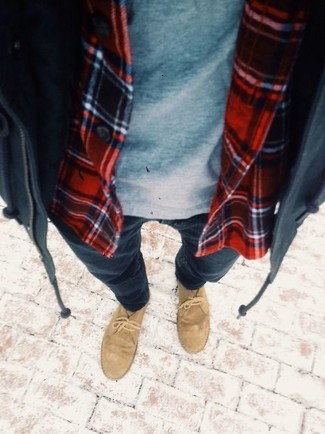 A parka and navy skinny jeans are a great outfit formula to have in your arsenal. A cool pair of khaki suede desert boots is an easy way to upgrade your look.