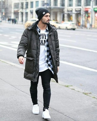 If you love staying-in clothes which are stylish enough to wear out, try this combination of a charcoal parka and a black beanie. White leather low top sneakers will instantly spruce up even the laziest of looks. Dressing warmly is the key to surviving cold temperatures, but this outfit is a good illustration that this can also be done with style.