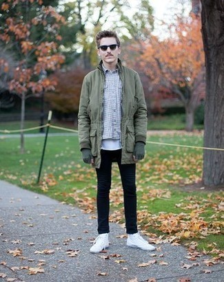 How to Wear Black Jeans In Cold Weather For Men: This relaxed casual combo of an olive parka and black jeans is effortless, sharp and very easy to copy. White canvas high top sneakers are a goofproof footwear option that's full of personality.