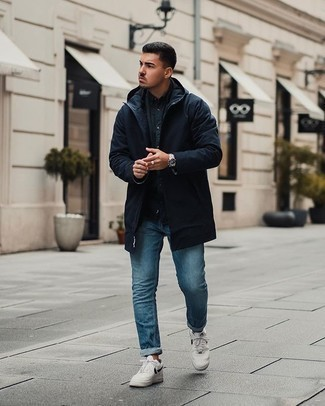 Blue Jeans Outfits For Men: A navy parka and blue jeans are amazing menswear staples that will integrate well within your casual wardrobe. Our favorite of a great number of ways to round off this ensemble is a pair of white and black leather low top sneakers.