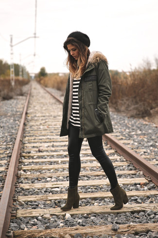 If you want to look cool and remain cosy, pair an olive parka with black leather leggings. A pair of olive boots looks proper here. You can see this getup is also a practical illustration of how to style warm clothes in the winter months.