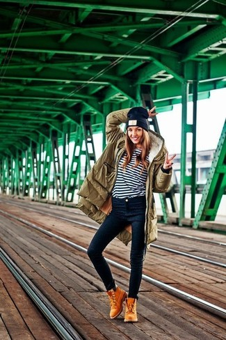 How to wear: olive parka, white and navy horizontal striped long sleeve t-shirt, navy skinny jeans, tan suede lace-up ankle boots